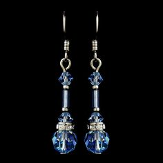 "These sparkling light blue Swarovski crystal earrings are the perfect way to bring an extra touch of romance to your wedding day. Perfect for your classic, modern, or vintage inspired wedding. 1.25"" ("