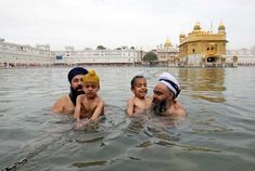 Sikh men and children taking a dip in the sacred pond of the Golden Temple in Amritsar, India Boko Haram Insurgency, Mark Thompson, Uk People, Songkran Festival, 5 Year Anniversary, Buddhist Meditation, Golden Temple, Hindu Festivals, Picture Editor