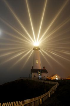 light - shining - Shining is  brightness from a source of light. This lighthouse is a source of light for its surroundings. This photo includes leading lines and balance.