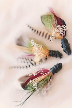A Winter wedding in Watertown, New York - Boutonnieres with duck feathers, bullets and fly fishing materials!