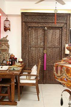 The kitchen exhibits a surprising design feature --- a massive Indian door.