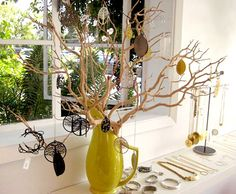 Pretty branch and vase combination. Simple white shelf is effective, as well.