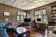 The exquisite molding on this home library's ceiling makes it a stand out!