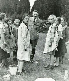 German Volk.  Hitler loved these posed photos that purported to show that he a man of the common people.