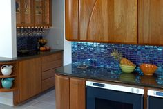 Stunning blue tile bacsplash in the kitchen and bar. Discovered on search.porch.com #interiors #interiordesign #decor