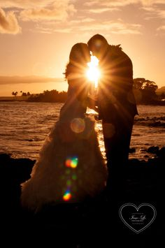 A gorgeous sunset at The Beach House, peeking through the newlyweds!