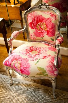 I love this chair with it's pink floral fabric.  Would be perfect in our bedroom.