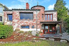 Spanish Eclectic Home's Rear Elevation with Lots of Windows for Access to Natural Light and Mountain View.  HGTV's Ultimate Homes