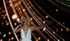 Russia Eurovision hopeful Polina Gagarina sailed into the final with a confident performance in the semifinal Tuesday, where she was met with neither boos nor catcalls, although rainbow flags, a symbol of gay pride, did notably appear when she performed. Rainbow Flag, Gay Pride, Finals, Concert, Moscow, Euro, How To Make, Times, Final Exams