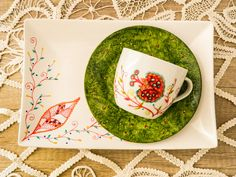 Christmas tea set, cup and serving dish, handpainted with leaves and flowers.