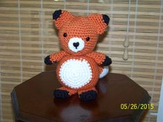 Stuffed fox-hand crocheted in orange black by MadeinMassachusetts