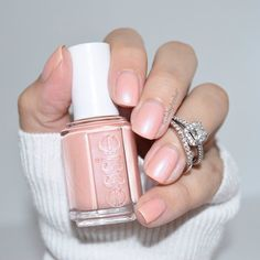 A coral kissed pink nail polish that's definitely 'worth the wait' for your wedding day.
