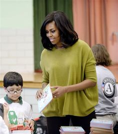 First Lady Michelle Obama participates in a community service project at Leckie Elementary school in celebration of the Martin Luther King, Jr. Day on Jan. 18, 2016.