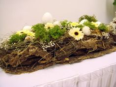 If your wedding reception has long tables, consider using floral displays with plants incorporated in them for a more lasting and unique arrangement. Shown here is a naturalistic display using a species of club moss for its interesting-looking foliage, Selaginella kraussiana 'Brownii',  which forms low, small clumps of whorled mounded leaves. Plants are potted up in small thumb pots which can serve as unconventional take-away souveniors for your guests.