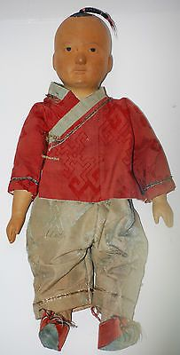"12-inches, A ""Door of Hope-type"" doll. Often mistaken for Door of Hope Mission dolls, these dolls are from unknown makers. The carving of the heads and hands are  similar to later DOH dolls, but obviously different once you become familiar with the DOH's. The hands are shorter and fatter, the face much rounder, as are the eyes. Also, the hairstyle on this doll is only on the DOH babies."