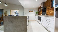 Kitchen design, Momdern kitchen, contemporary kitchen, concrete island bench, waterfall island bench, timber splashback, black glass splashback, timber kitchen, concrete kitchen, polished concrete floors