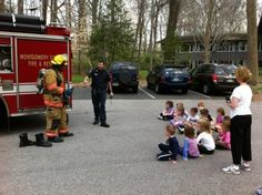A couple of days ago Lieutenant Sam Villani, Fire Station 5-D Shift, and crew stopped by a local day care to teach the kids about fire prevention and to show them how a fire fighter gets dressed to go into a fire.  Assisting Lieutenant Villani is Fire Fighter Andrew Randolph while Master Fire Fighter Wayne Malcolm works the camera.