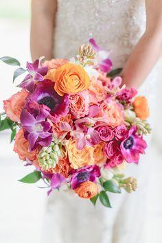 A bright bouquet full of orange, fuchsia, and magenta florals. Photo: @meewmeewstudios Magenta, Flower Arrangements, Florals, Wedding Flowers, Bouquet, Rainbow, Bright, Orange, Floral