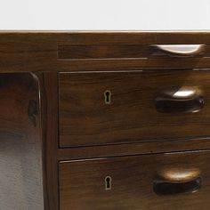 Johannes Hansen desk Denmark, 1957 rosewood, brass 61 w x 31.5 d x 29 h inches Desk features four drawers and two pull-out work surfaces.