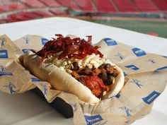 Meat Lover's Dog, Great American Ball Park (Cincinnati Reds)  A quarter-pound hot dog from Cincinnati's Queen City Sausage wrapped in bacon, deep fried, and topped with black-bean chili, shredded pepper jack cheese and crispy salami strips, served on a Klosterman Baking Co. hoagie bun.
