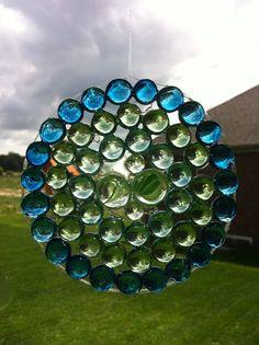 EASY PEASY GEM SUNCATCHER WITH ELMERS GLUE!!! http://www.ramblingsofasuburbanmom.com/2012/07/craft-time-glass-gem-suncatchers/