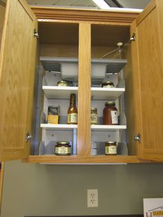 Cabinets with storage mechanisms that lower cans or jars are steady and can hold a normal shelf full of groceries