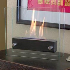 The Irradia fireplace is Nu-Flame's most popular model. It's easy to see why, given its light, simple, and timeless design that still manages to feel contemporary. Due to the glass panels' exquisite design, the fire is visible from every angle. Tabletop Fireplaces, Bioethanol Fireplace, Indoor Fireplaces, Portable Fireplace, Ethanol Fuel, Black Fireplace, Faux Fireplace, Fireplace Ideas, Fireplace Mantels