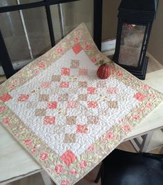 Looking for quilting project inspiration? Check out Mini Charm Square Table Topper by member Taunja K..