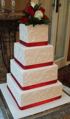 Red and white square wedding cake