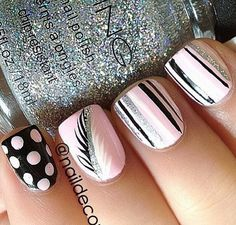 Pretty pink and silver nails with feather design