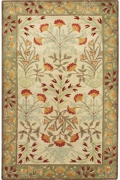 """Camila Area Rug - $959 + ship - 9'9""""x13'9"""". The Camila Area Rug is hand-tufted of a New Zealand wool blend that gives it a plush look and feel. This beautiful floral rug will work well with a variety of design styles. A special multi-step washing process highlights its beauty giving it an expertly crafted look. Has a thick, generous pile for plush texture. Quality crafted for precise detailing and lasting quality. Available in a variety of colors."""