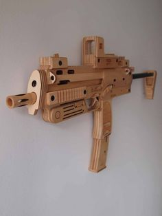 Splinter-Sell (a clever pun on the computer game Splinter Cell) is the online Etsy store run by UK artist Jenni Edwards. Jenni builds replica guns from wood, mainly maple and birch. The FN SCAR replica pictured below features a magazine release, adjustable butt-stock, moving cocking lever, and a trigger that drops an internal hammer. The parts are laser cut and assembled by …   Read More …