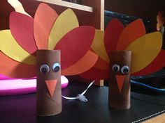 Hanging thanksgiving turkeys made out of toilet paper rolls