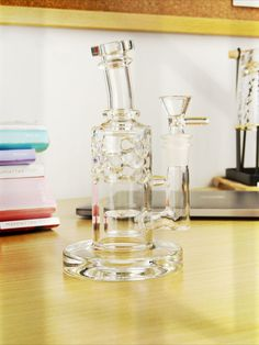 """This Swiss FOL Perc Mini Bong stands at a small size of 6.5"""", it is a perfect piece for on the go. With the bent neck design, it will prevent splashback and paths to your mouth. Super smooth balance for flavor and airflow through the Swiss percolator and Flower of Life percolator. Bongs Online, Glass Bongs, Smoking Accessories, Splashback, Neck Design, Flower Of Life, Water Pipes, Wine Decanter, Paths"""