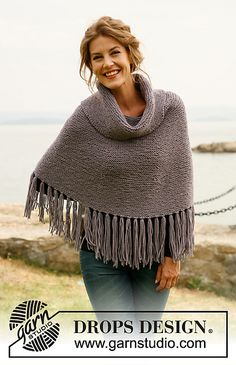 "Ravelry: 134-15 b - ""Pompom"" - Poncho with fringes and large collar pattern by DROPS design"