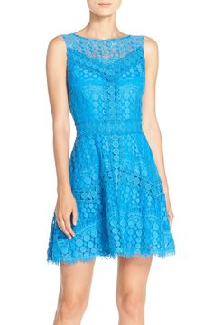 Tonal dotted lace brings romantic charm to this sleeveless dress with a lightly pleated, flared skirt.