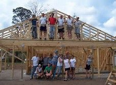 It takes a village to build a hut!