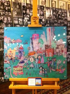 I really love this idea for auction. Kids could do a self portrait and a city landmark (they choose their favorite) and adult can cut out/collage them together (kids could sign name on shirt - maybe thumbprint in center of balloon and sign? - add all to collage as teacher holding balloon bouquet?)
