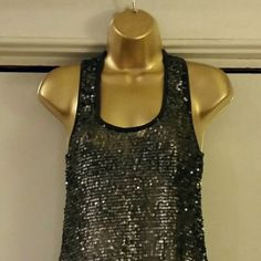 Sequin Covered Tunic Style Overlay Top Sm/Med Material is a sheer dark navy and the sequins are dark metallic silver/gray in color.  Very good condition with no missing sequins or fraying.  This tunic style top would look great paired with a navy tank, leggings and heels.  All sparkle! h.i.p. Tops Tunics