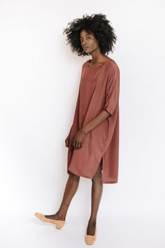 """The silk dress in marsala from Revisited Matters features a loose fitting silhouette with short sleeves and side slits. Also available in black. Model is 5'9"""". - One size fits most - 100% Silk - Dry c"""