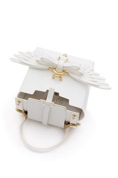 Niels Peeraer, Small Wings Shoulder Bag Niels Peeraer's small shoulder bag in the brand's signature crisp white hue comes with a bold and playful wing bow at the front that is also detachable., Chunky gold-tone hardware, Detachable top handle and shoulder straps, Flap over top with slip-through strap closure, 100% leather, Made in Spain