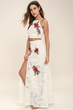 The Take a Vow Ivory Lace Two-Piece Maxi Dress is a promising pick for any engagement! Romantic red and green floral embroidery decorates an ivory lace (with a nude liner) crop top with adjustable skinny straps and an exposed silver zipper/clasp at back. Matching maxi skirt has an elasticized waist and thigh-high, side slit. Exposed back zipper/clasp.