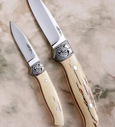 Featured in April 2012 Blade Magazine Steel: XHP Carpenter Stainless Steel top – 3 3/4″ OAL 8 3/4″ bottom – 2 3/8″ OAL 6 1/4″ Handle material: Mammoth Ivory with red spacers. Bolsters : 416 Stainless steel Engraving: Nathan Dickinson Featured in April 2012 Blade Magazine