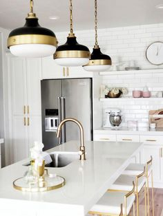 whitelanedeco Feiss Candence Pendant brass black and white kitchen Delta Trinsic Faucet open shelving with subway tile brass par pull and with white cabinets Fuji gold ba. Home Decor Kitchen, Interior Design Kitchen, Kitchen Ideas, Kitchen Designs, White Kitchen Interior, Gold Home Decor, White Kitchen Decor, Decorating Kitchen, Kitchen Images