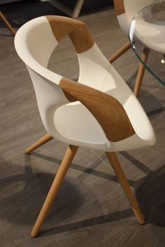 The leggy chairs have the most intriguing and elegantly curved arms