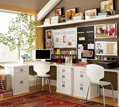 nice office with white desks, lots of storage up the high walls and warm paint color on wall