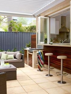 Bi-fold Kitchen Windows with outdoor BBQ close by.