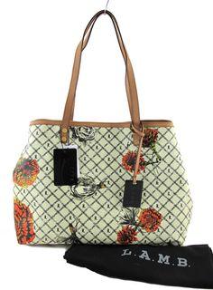 My newest bag! Love it! L.A.M.B Signature Williamsfield Marigold Tote. ( I got mine at TJ Maxx for a steal!)