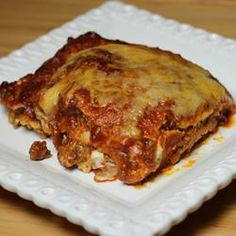 Mexican Lasagna Lite - This is a lower-fat version of a popular Tex-Mex style casserole. You can increase or decrease the number of tortillas used in order to fit your tray. Ww Recipes, Recipe Lists, Mexican Food Recipes, Great Recipes, Cooking Recipes, Good Food, Yummy Food, Tasty, My Favorite Food