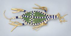 55175: A SIOUX BEADED HIDE UMBILICAL FETISH c. 1890 in : Lot 55175